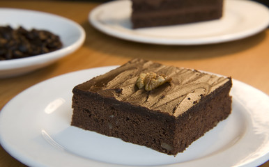 Chocolate brownie with a walnut