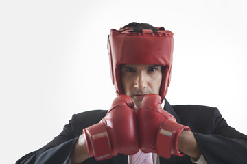 Portrait of businessman with boxing gloves