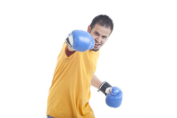 Portrait of young man in fighting stance isolated over white background