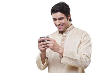 Bengali man reading an sms