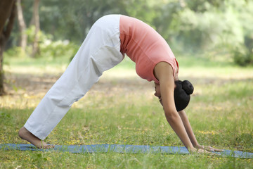 Woman in downward yoga pose
