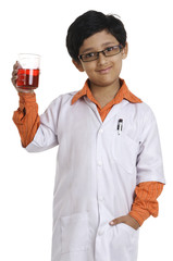 A boy dressed as a scientist
