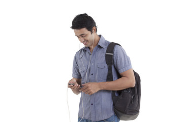 Smiling young man listening to music