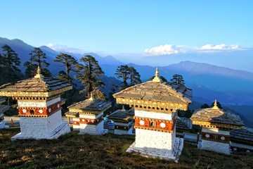 The 108 chortens (stupas) is the memorial in honour of the Bhutanese soldiers with layer of mountains at  Dochula Pass on the road from Thimphu to Punaka, Bhutan