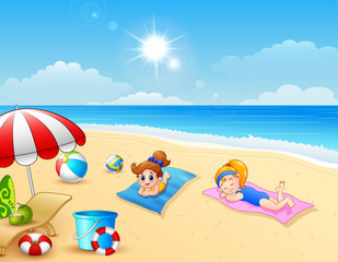 Two girl sunbathing on the beach mat