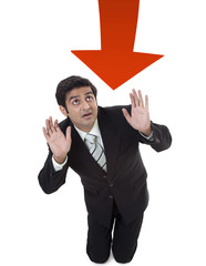 Young businessman protecting himself from arrow sign