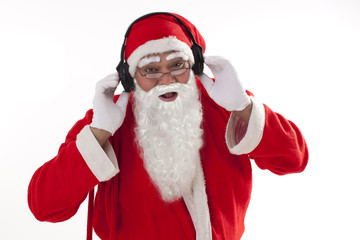 Portrait of Santa Claus listening to music over white background