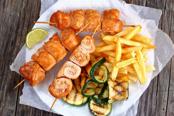 chicken shish kebabs with french fries