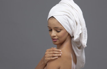 Close-up of beautiful woman with a towel on head