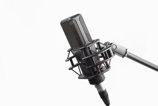Professional studio microphone on stand, isolated on white