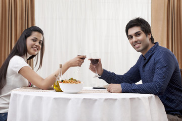 Portrait of a happy young couple on a date at restaurant