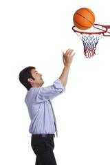 Executive playing basketball