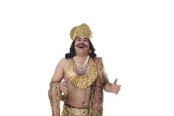 Man dressed as Raavan laughing