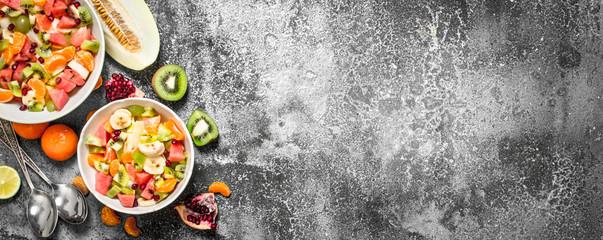Tropical food . Fresh salad of fruits.