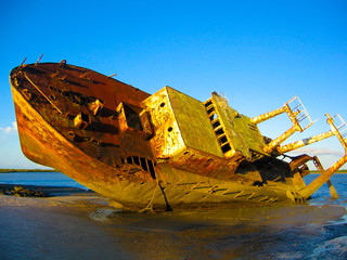 Canvas Prints Ship An old grounded shipwreck on a beach in Mozambique