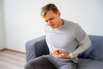 Guy suffering from a stomachache