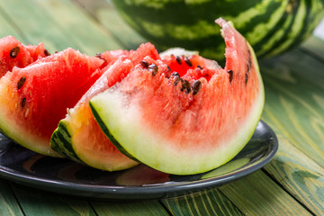 Watermelon on a green wooden background