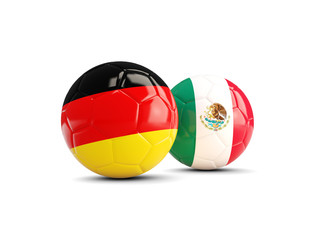 Germany and Mexico soccer balls isolated on white background