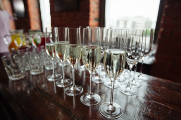 Many glasses of champagne over blur glasses background