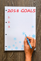 Personal and professional goals list for the New Year 2018 on math book