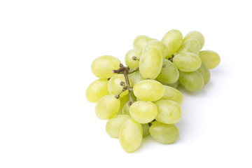 Bunch of green grapes on white background.