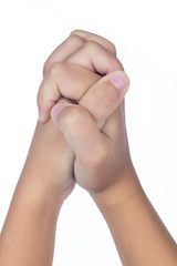 Child's hands folded together in prayer