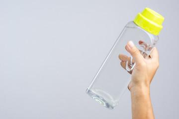 Hand holding full 1.4 lites water bottle