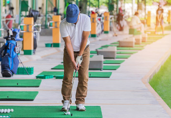 golfer during practice driving range in golf course yard signs Wall mural