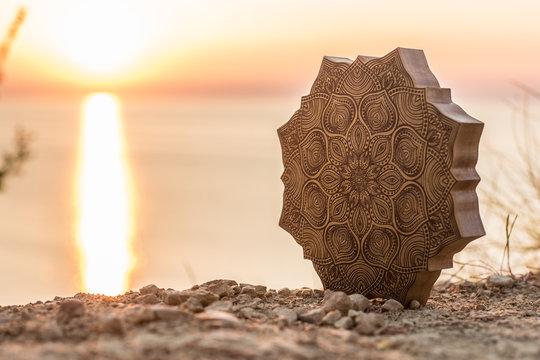 Mandala with a beautiful sea and sunset background