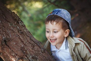 Closeup portrait of beautiful little boy in the Park