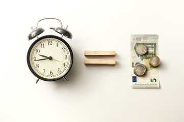 Business concept old vintage alarm clock money key. Time is money. Free money, waste time