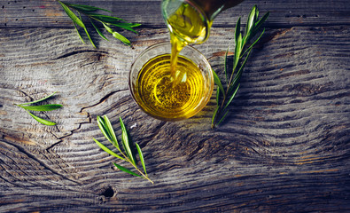 Olive oil with olive twig