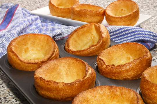 freshly baked yorkshire pudding in a baking tray