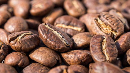Roasted coffee beans, backgrounde. Macro. Close-up