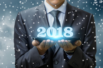 Businessman showing 2018 new year .