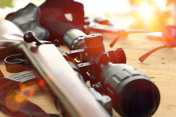 Foto auf Gartenposter Jagd close up of rifle telescope for sport hunting on table wooden