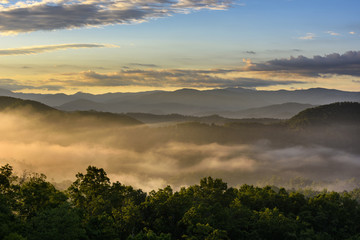 Fototapete - Mountain View at Sunrise with Fog in Valley