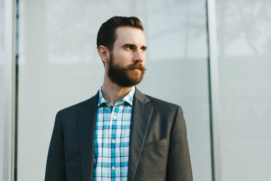 Young Business Professional With A Beard and Suit Jacket