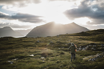 Travelers Exploring in Klaksvik Mountains in the Faroe Islands