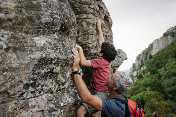 Father and Son Rock Climbing