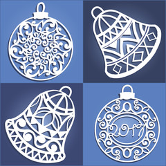Set of openwork Christmas decorations. Laser cut paper christmas bell . Christmas decorations for wood carving, paper cutting
