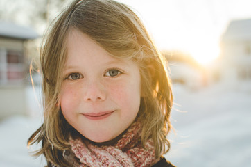 Child smiling on a snowy day