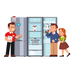 Shop assistant showing refrigerator to clients