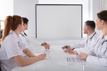 Doctors Looking At White Board