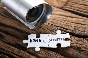 Closeup Of Home Security Jigsaw Pieces By Security Camera