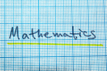 The word mathematics in a notebook for drawing.
