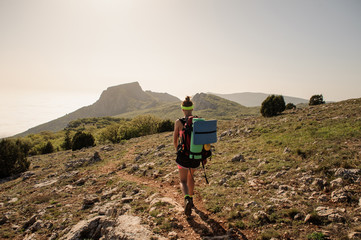 Traveler on top of mountains. stylish women hiking. atmospheric moment
