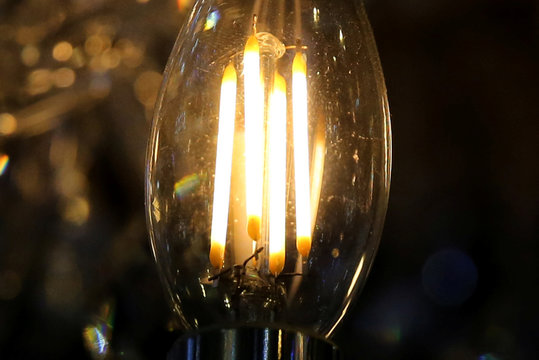A light bulb in a lamp is seen at a shop in down town Lima, Peru