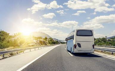 Bus rushes along the asphalt high-speed highway. Wall mural