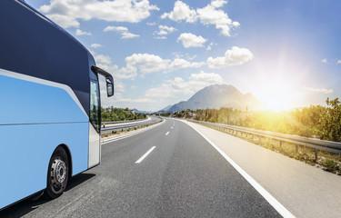 Bus rushes along the asphalt high-speed highway.